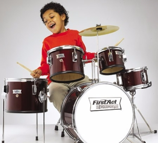 boy playing drum kit